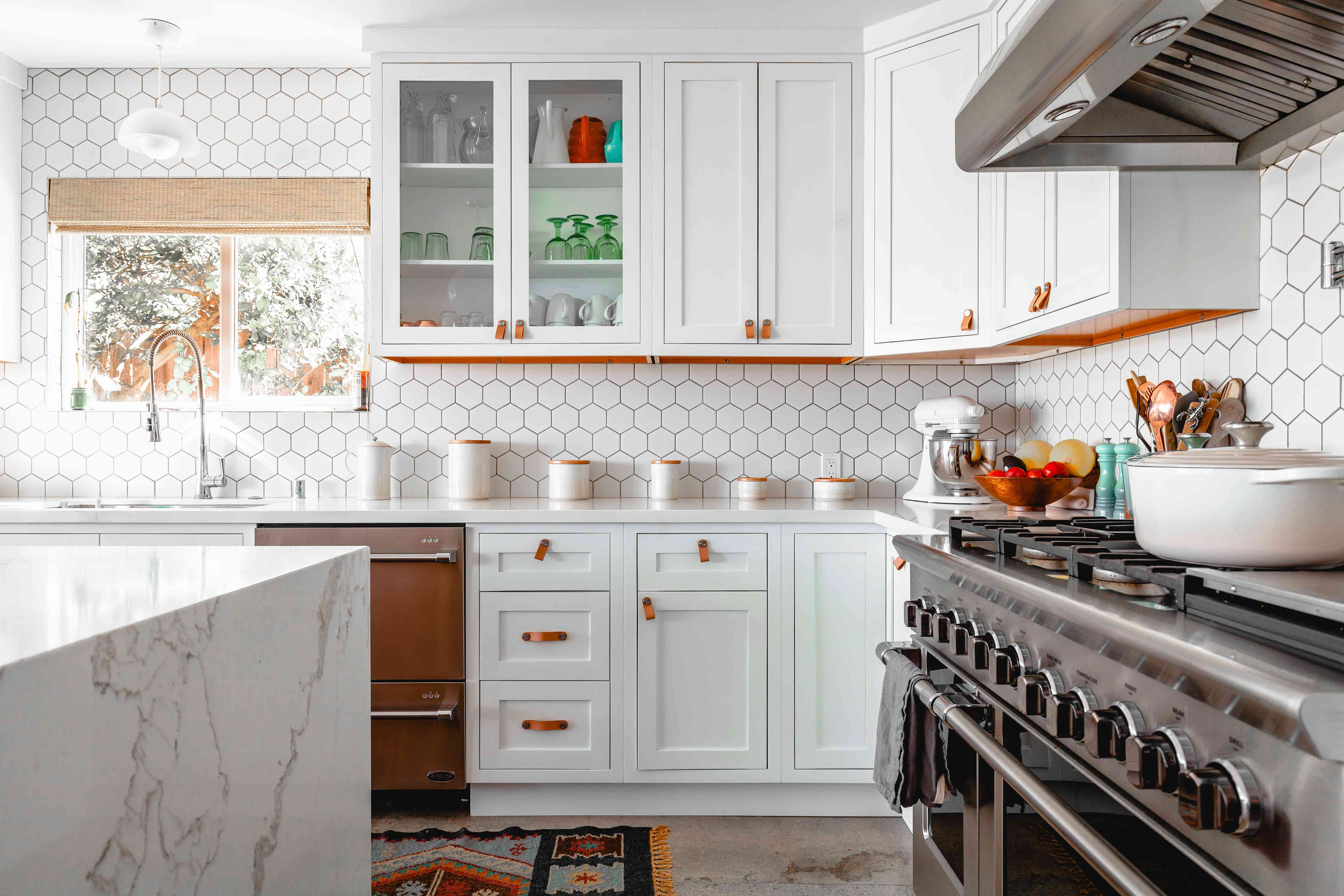 modern white kitchen with a large stove