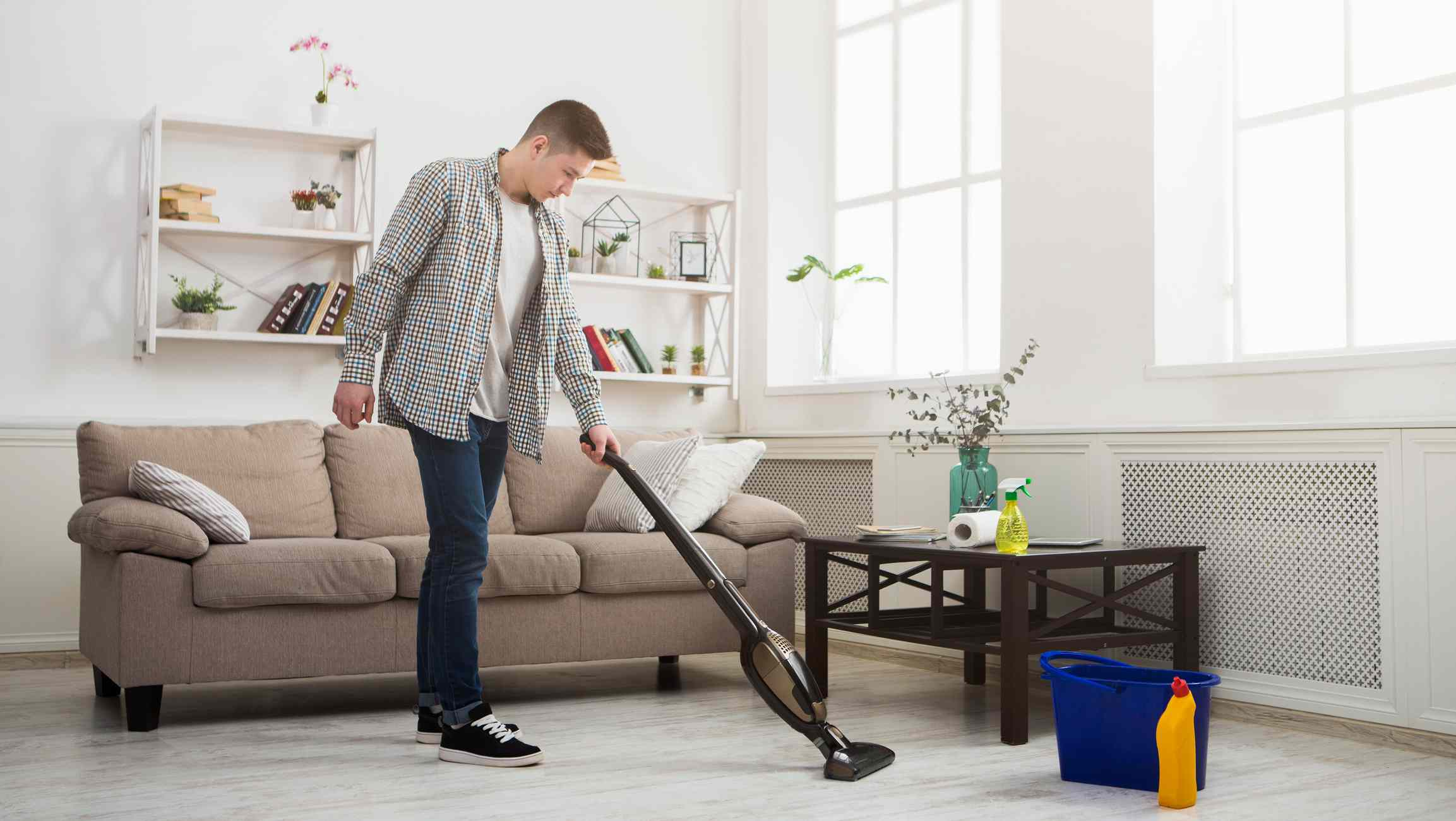 person vacuuming the living room