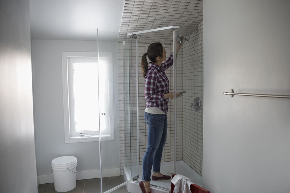 Woman replacing shower head