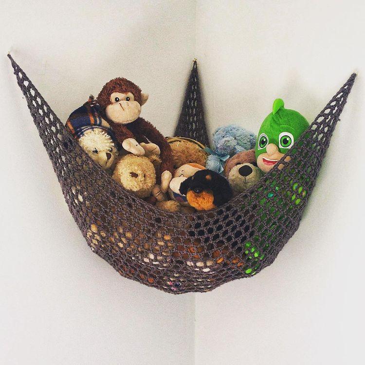 Mesh storage hammock with stuffed animals