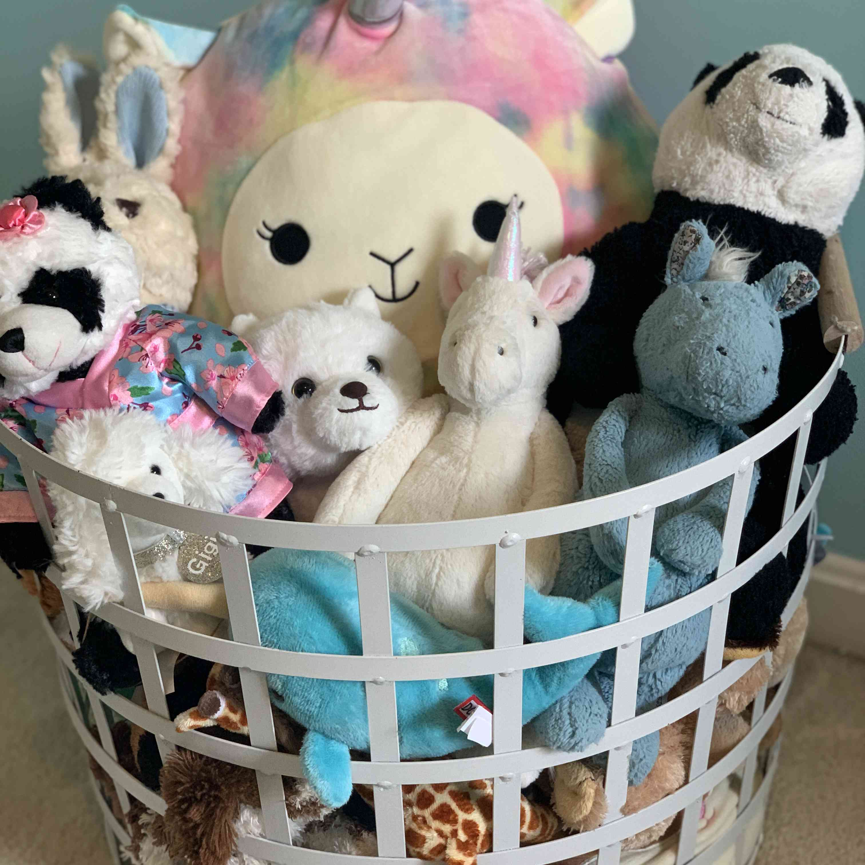 Sorage basket full of stuffed toy animals