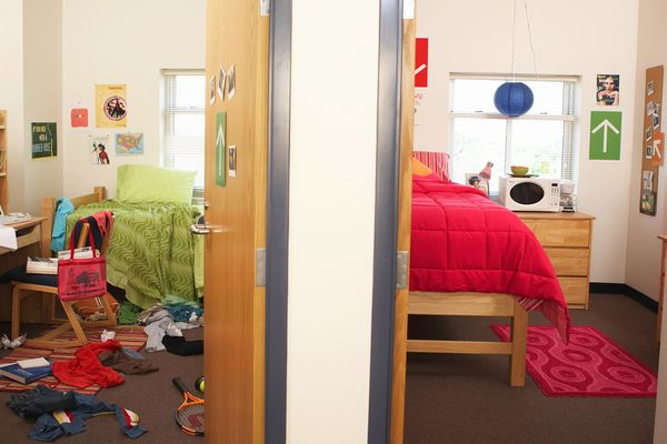 One messy and one neat college dorm rooms