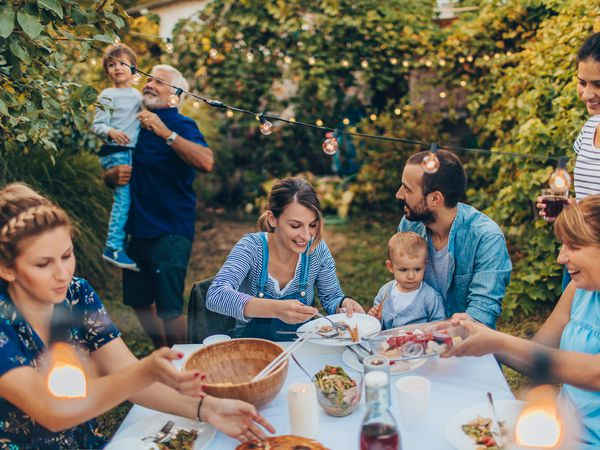 A family eating outdoors