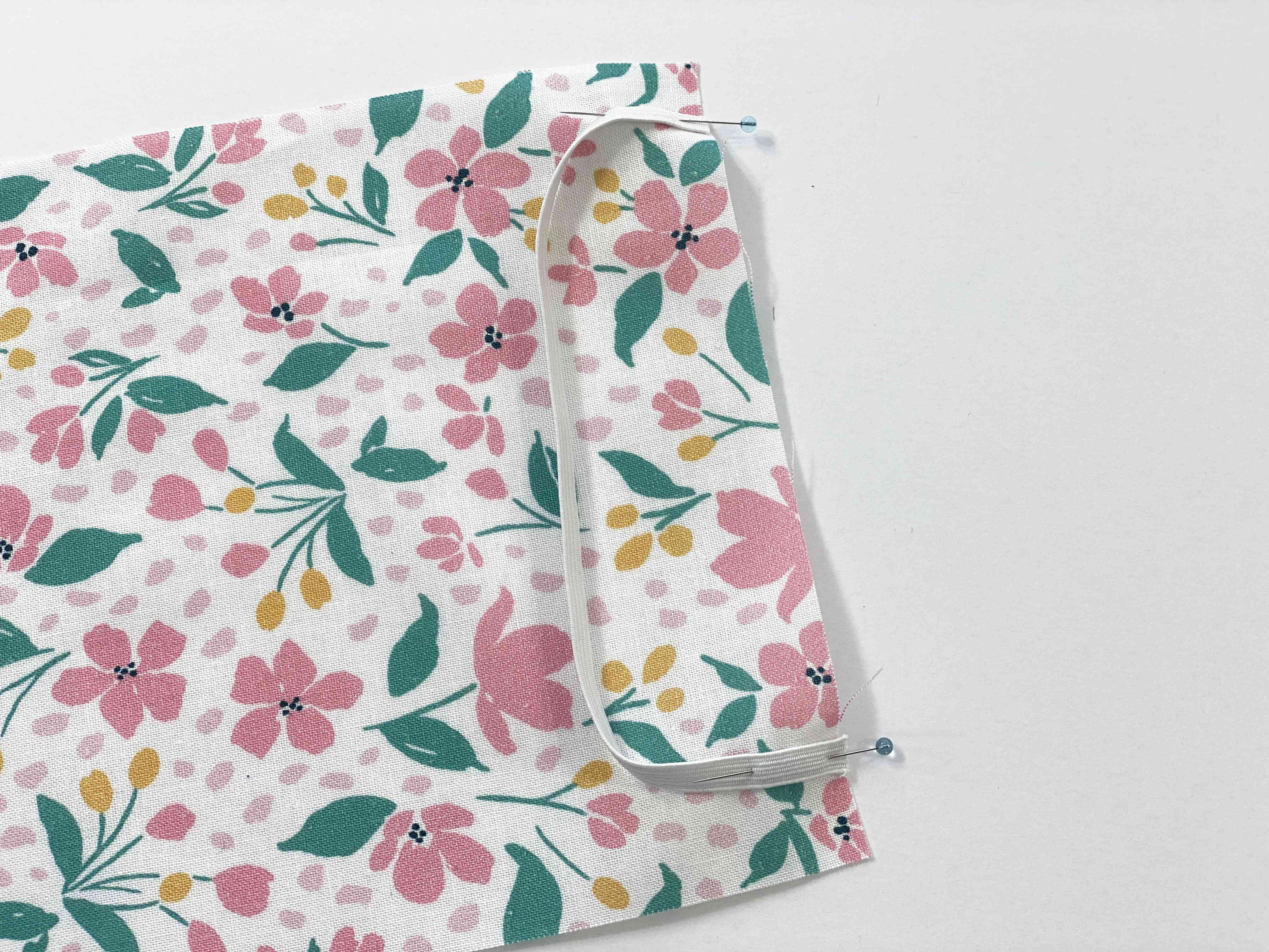 Elastic pinned to floral fabric