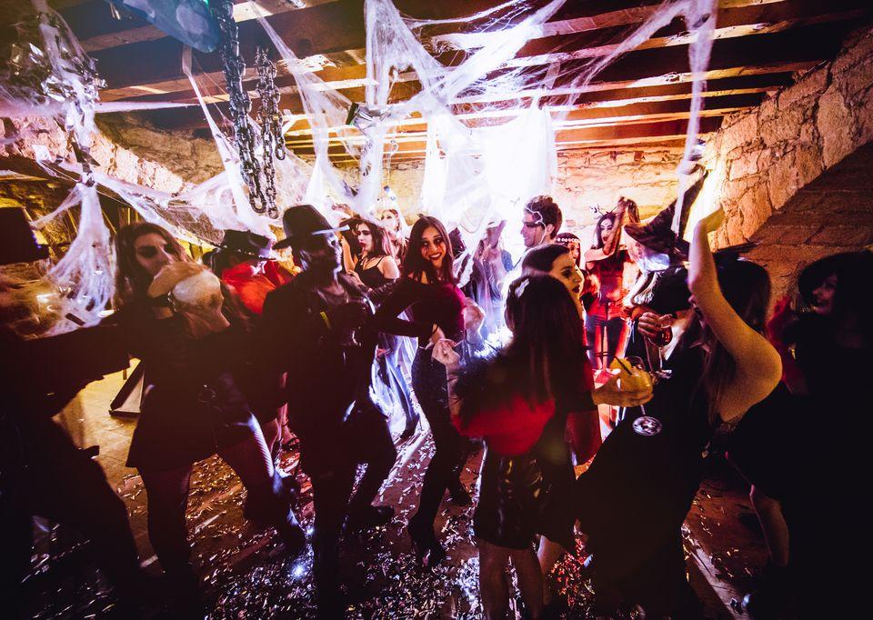 Multi-ethnic people in Halloween costumes having fun at nightclub