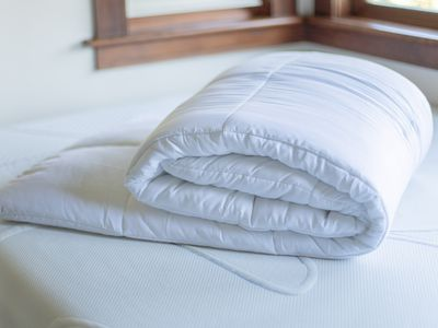 comforter folded on top of a mattress