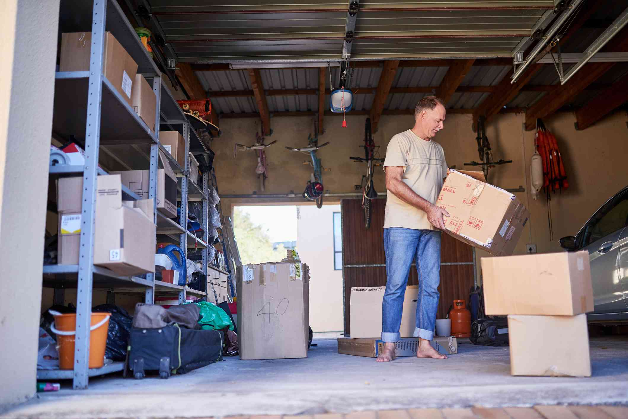 person moving boxes in a garage