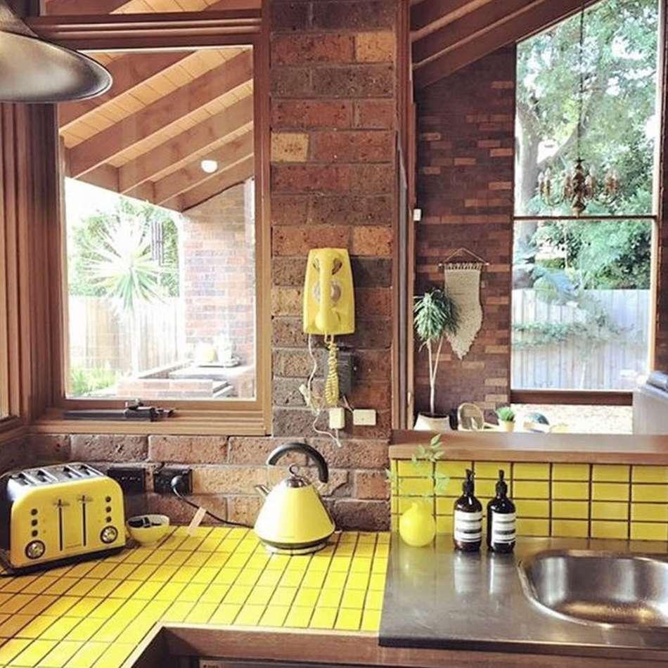 kitchen with yellow tiles and backsplash