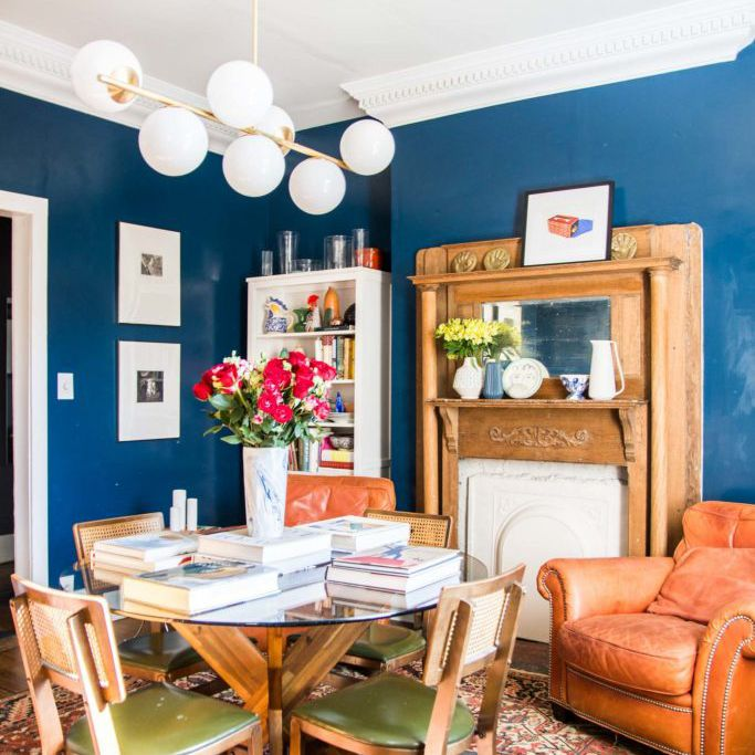 blue dining room with orange accents