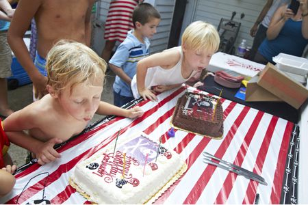 5 Year Old Twin Boys Blowing Out Birthday Candles