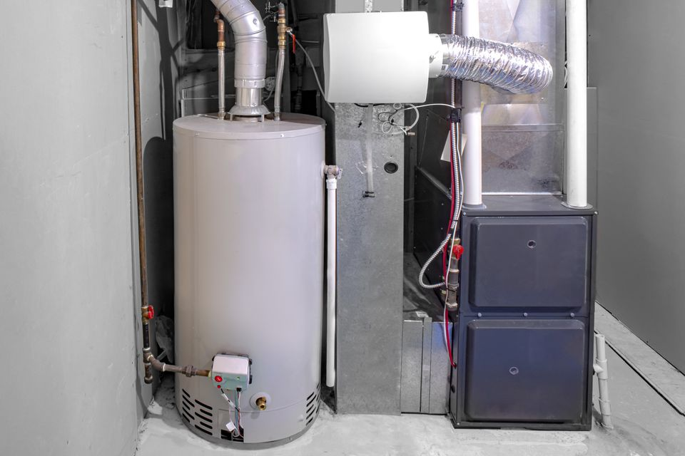 A home high efficiency furnace with a residential gas water heater & humidifier.