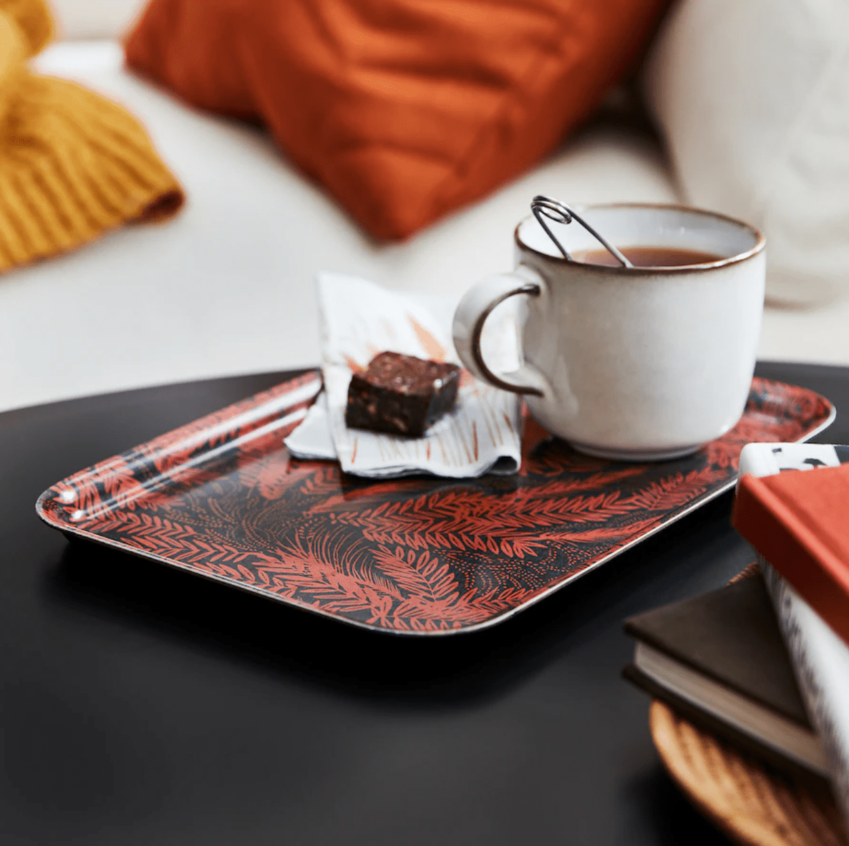 A food serving tray with red and black leaf pattern