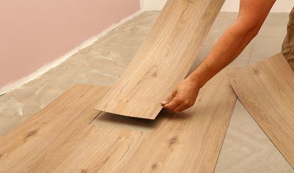 person installing vinyl flooring