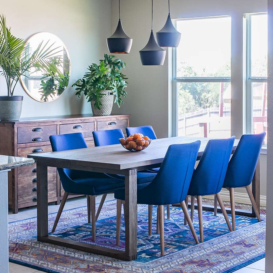 blue dining chairs and rug
