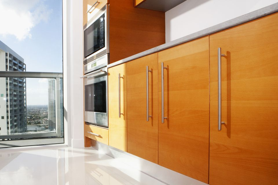 A modern kitchen with slab cabinet doors