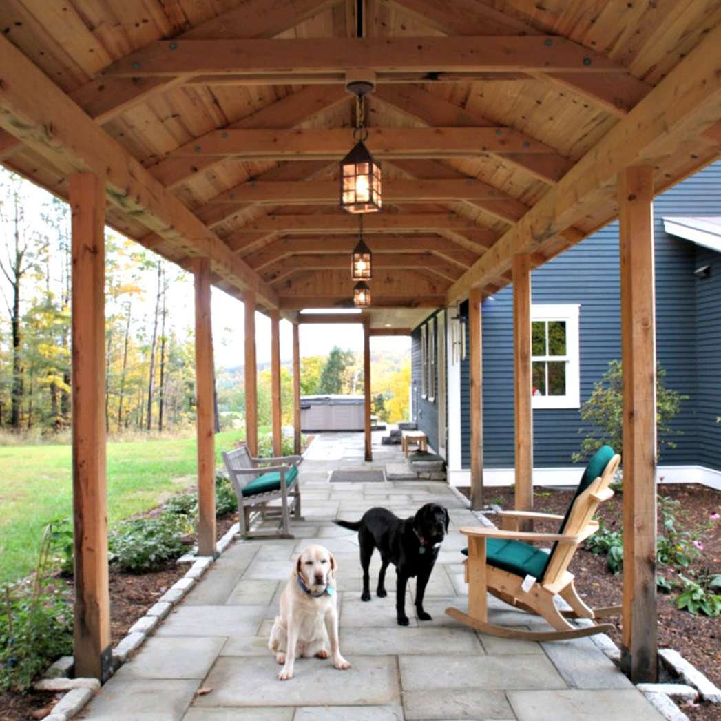 covered walkway with beige dog and black dog