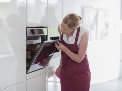 woman using wall oven
