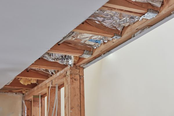 Load bearing wall with exposed ceiling and wooden structures