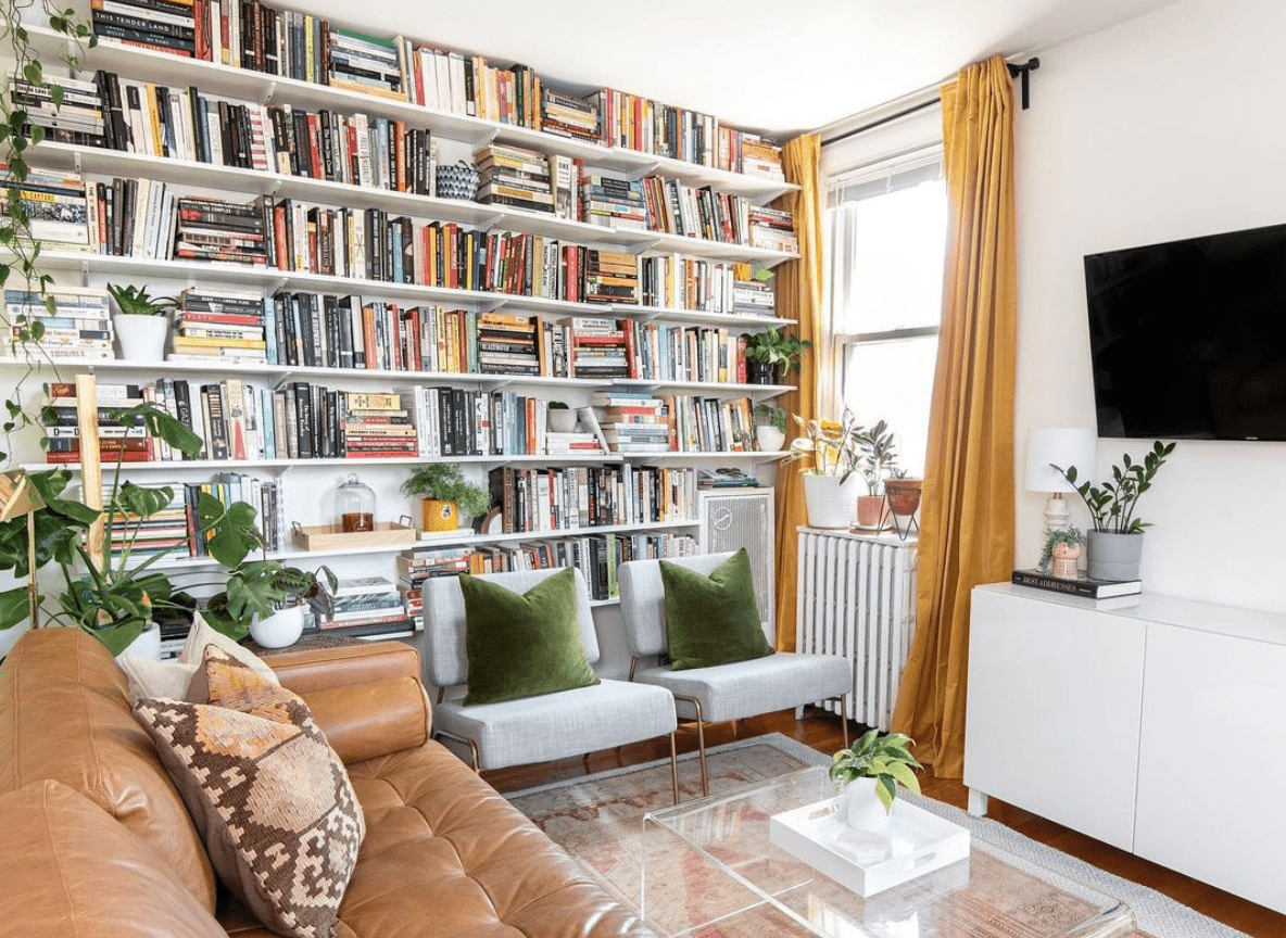 A large bookshelf in a living room.