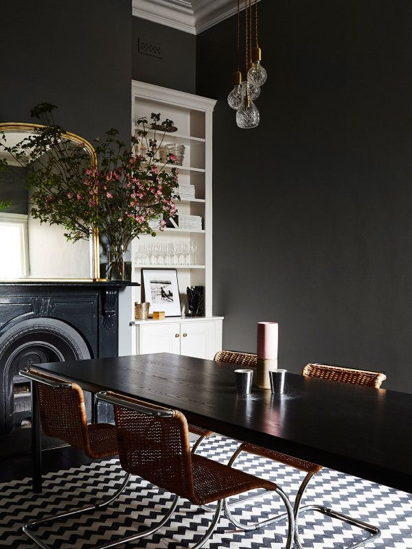Black dining room with checkered floor