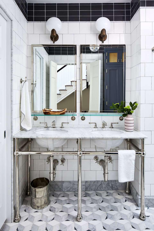 Globe sconces over bathroom vanity
