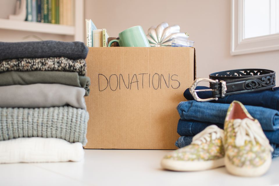 Box labeled donations next to household items