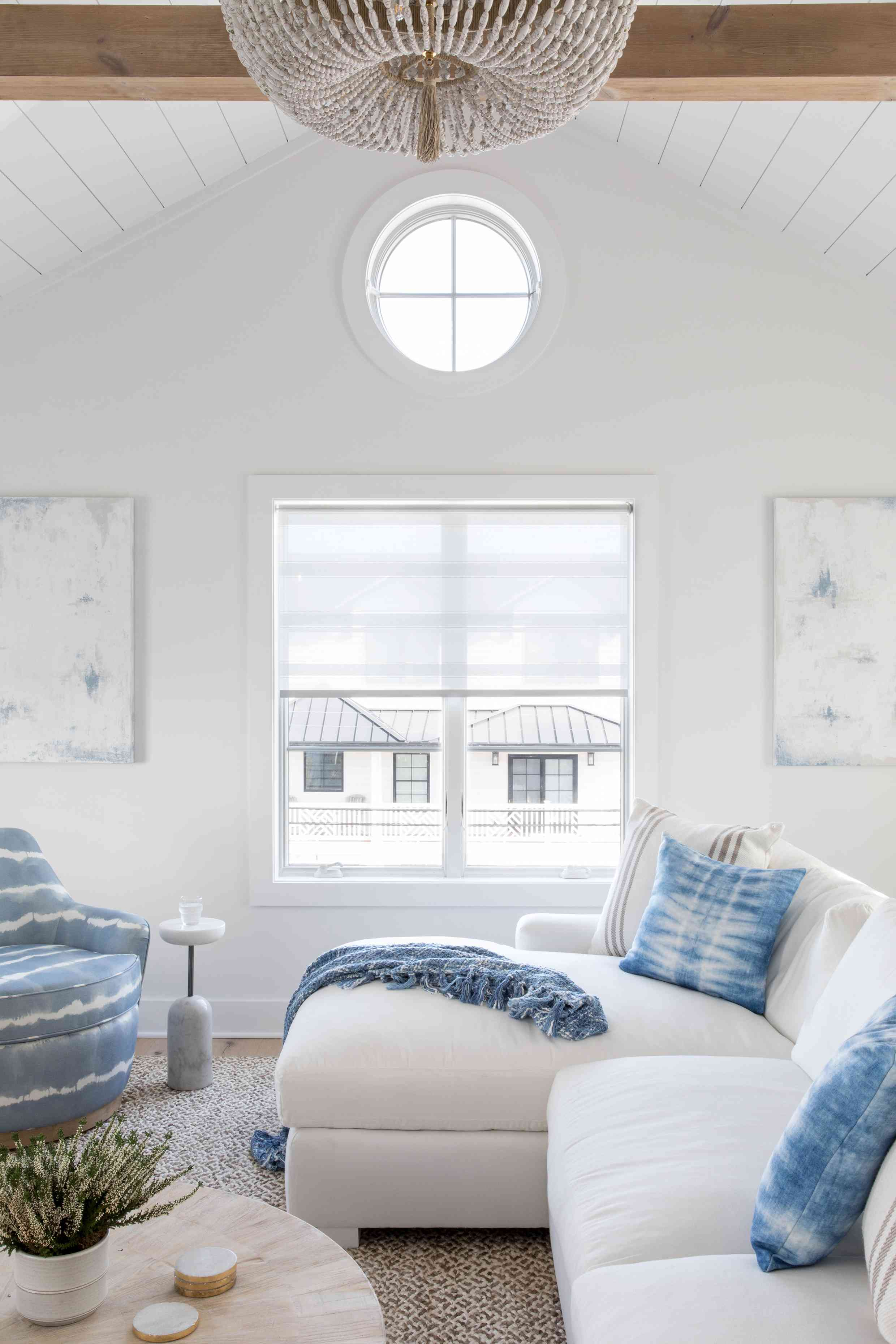 Karen B. Wolfe's Long Beach Island living area with portal windows and raised ceilings