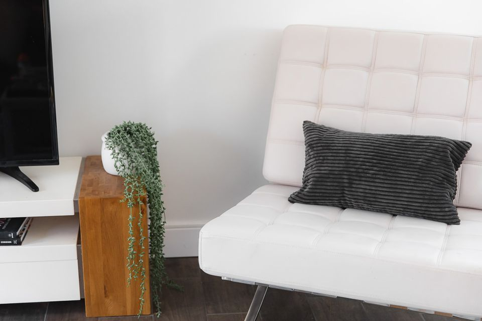 furniture in front of baseboards