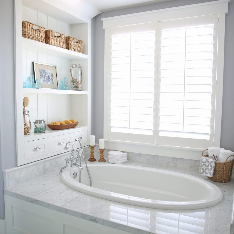 Tub surround with window