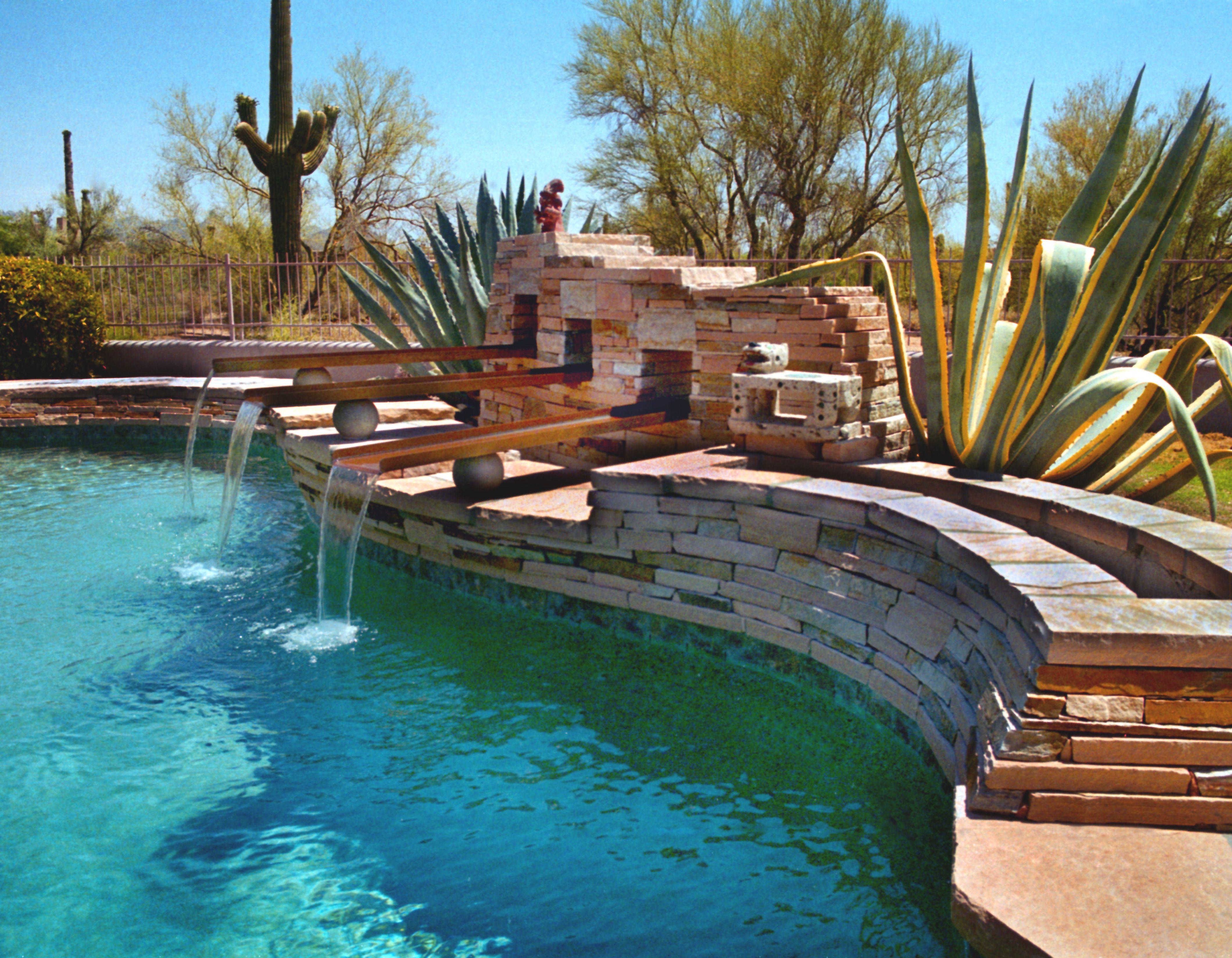 Desert landscaping around pool