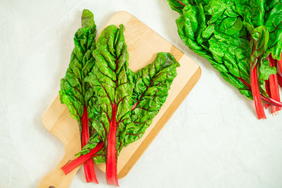 swiss chard on a cutting board