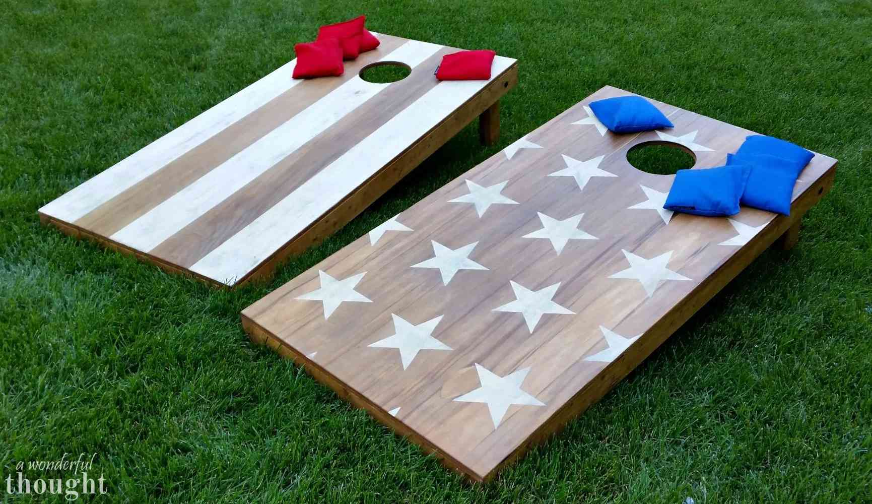 Two cornhole boards with red and blue bean bags