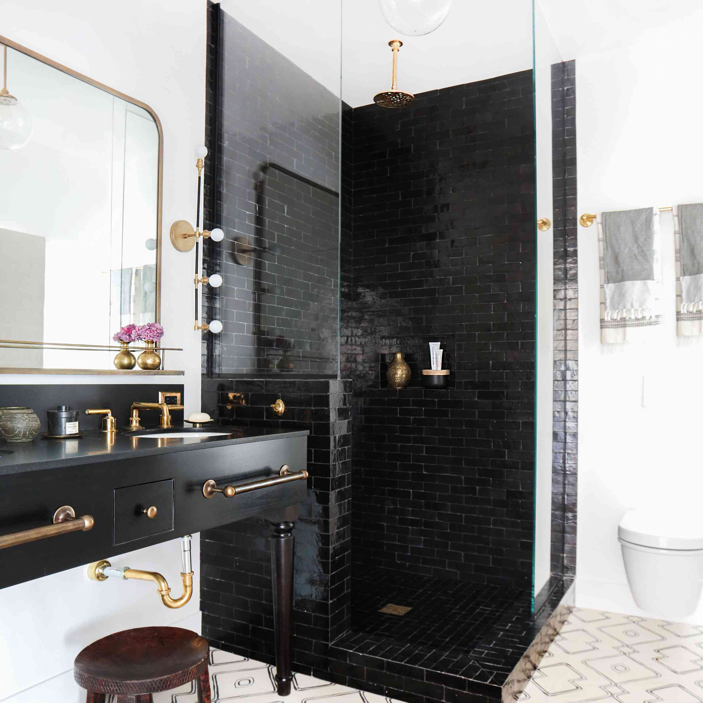 Black subway tile in bathroom