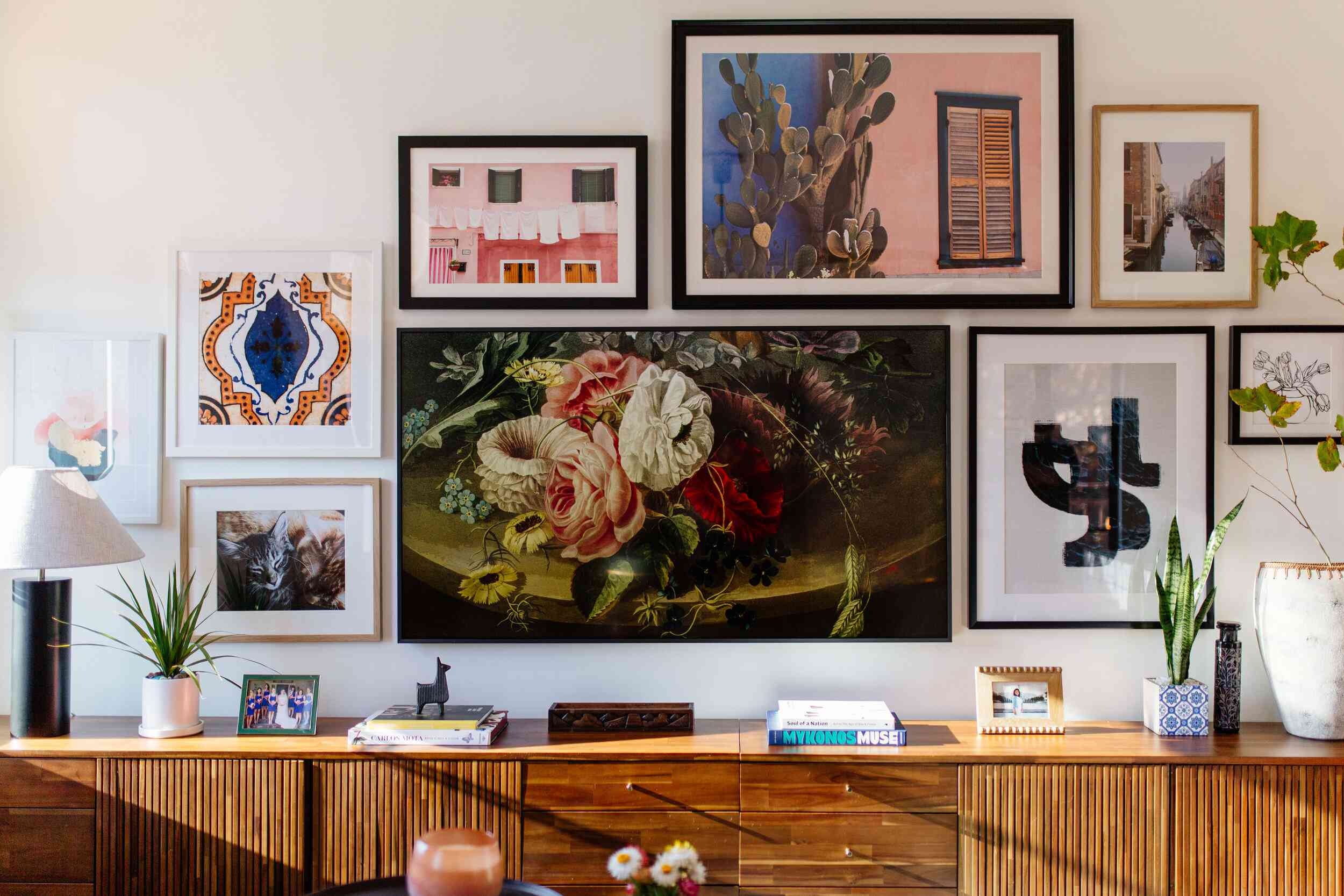 Curated gallery wall above a midcentury console