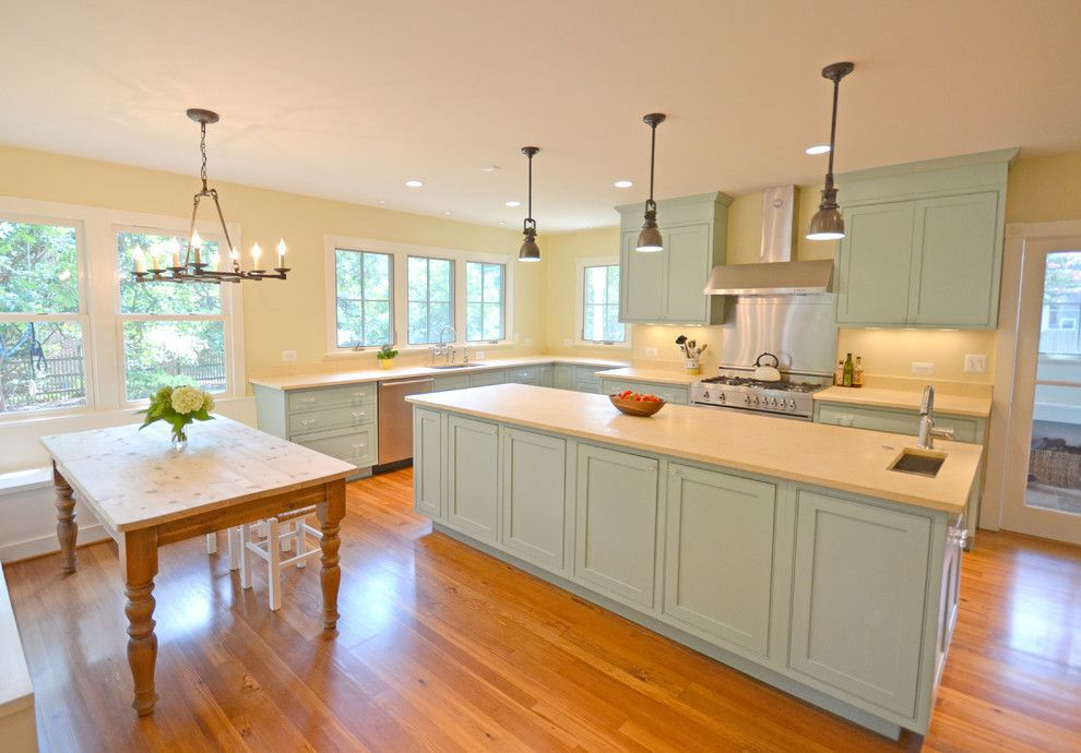 mint green kitchen with limestone countertops