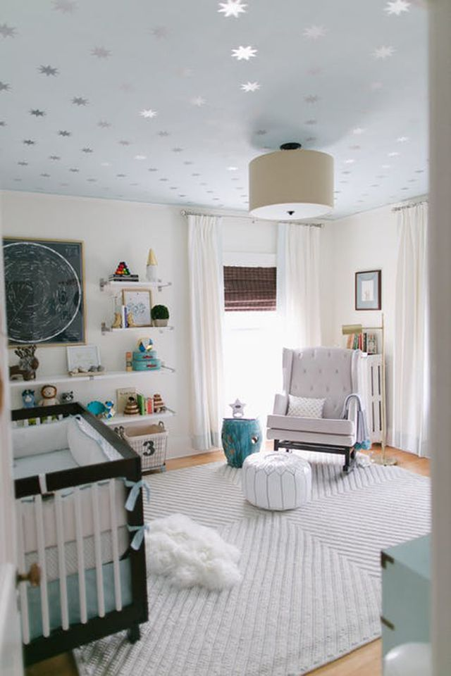 Space-themed nursery room with metallic star ceiling