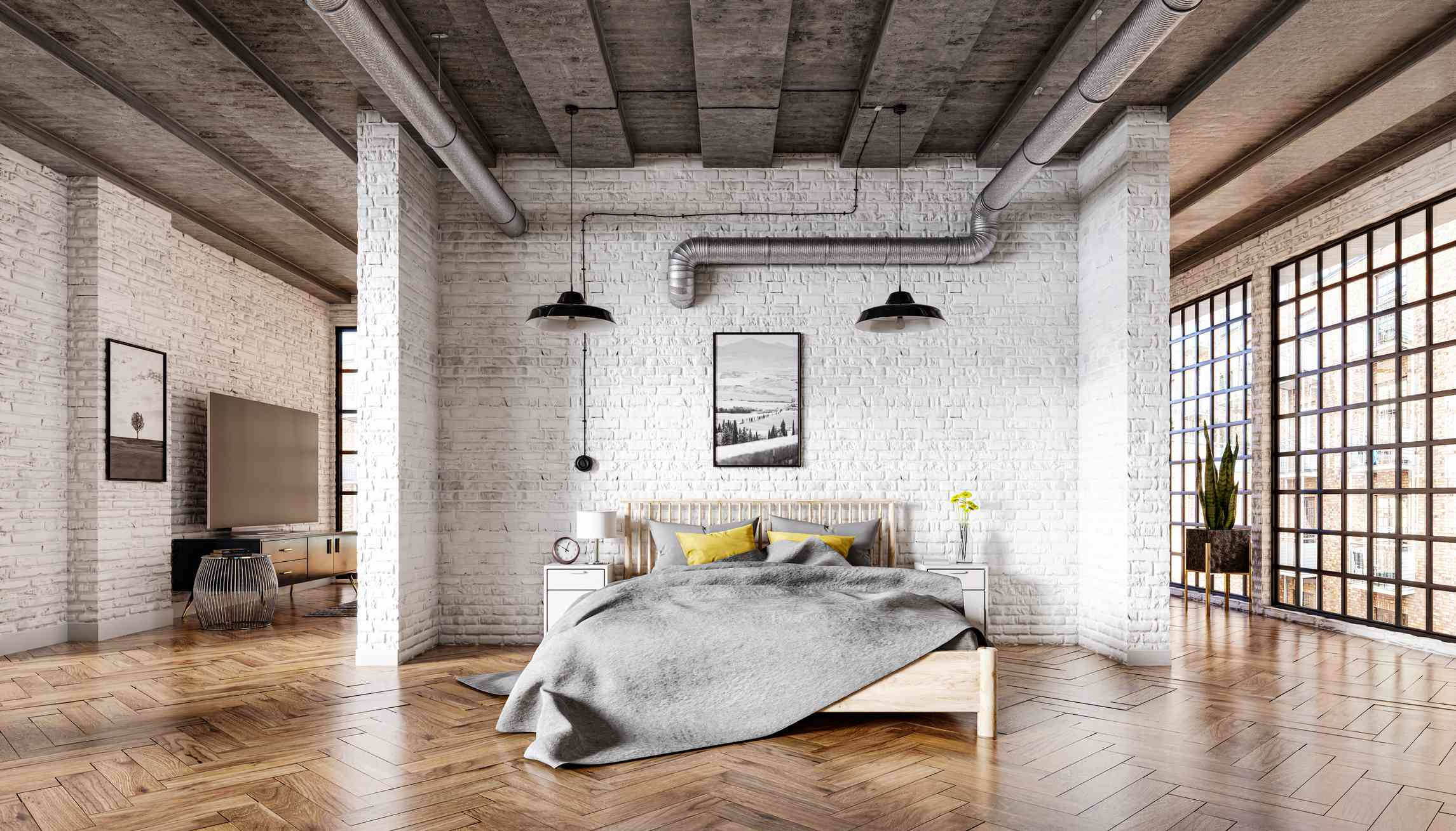 Bedroom in a loft interior with a brick wall, parquet floor and a concrete ceiling