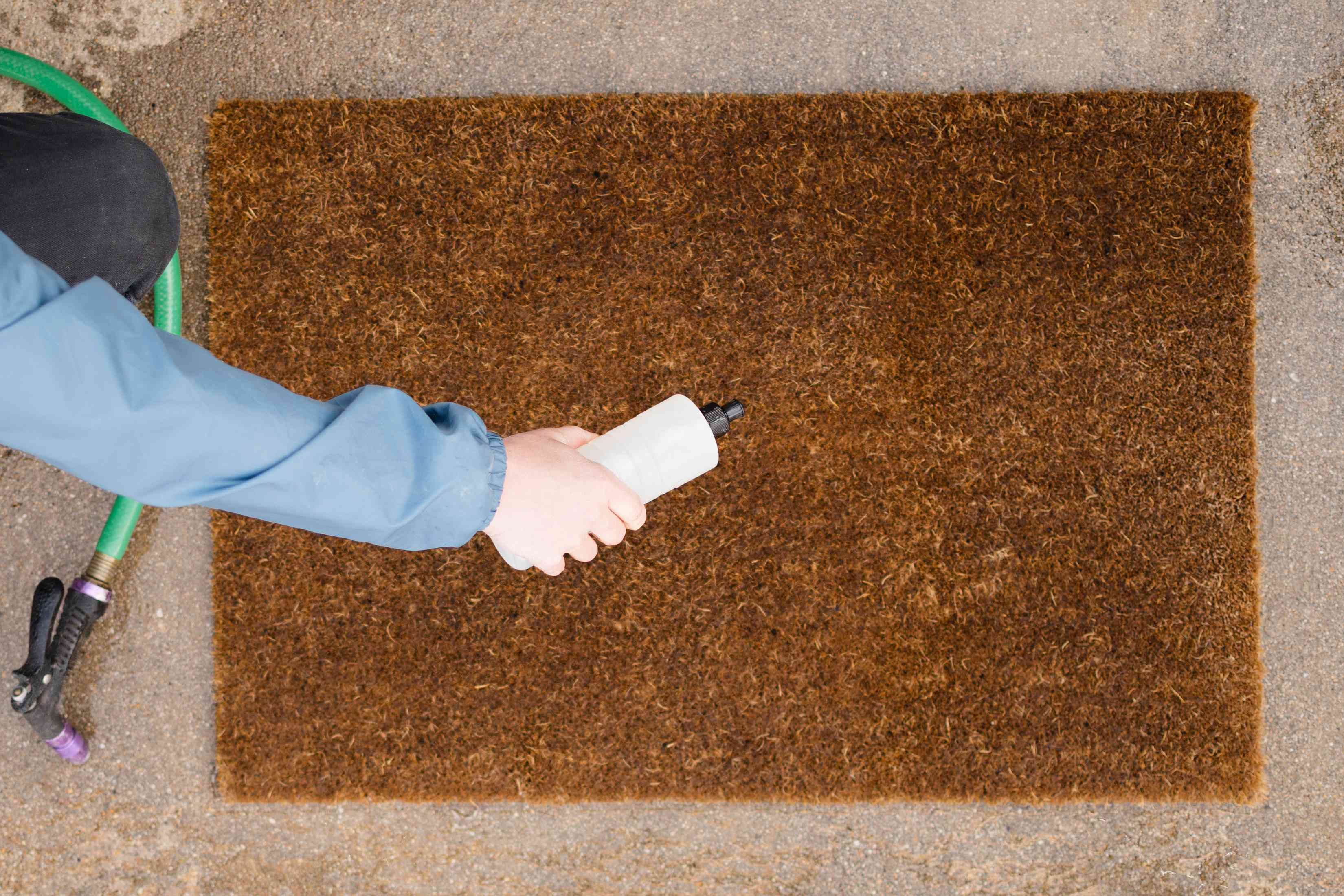 Mild dish soap added to tough spots on brown doormat