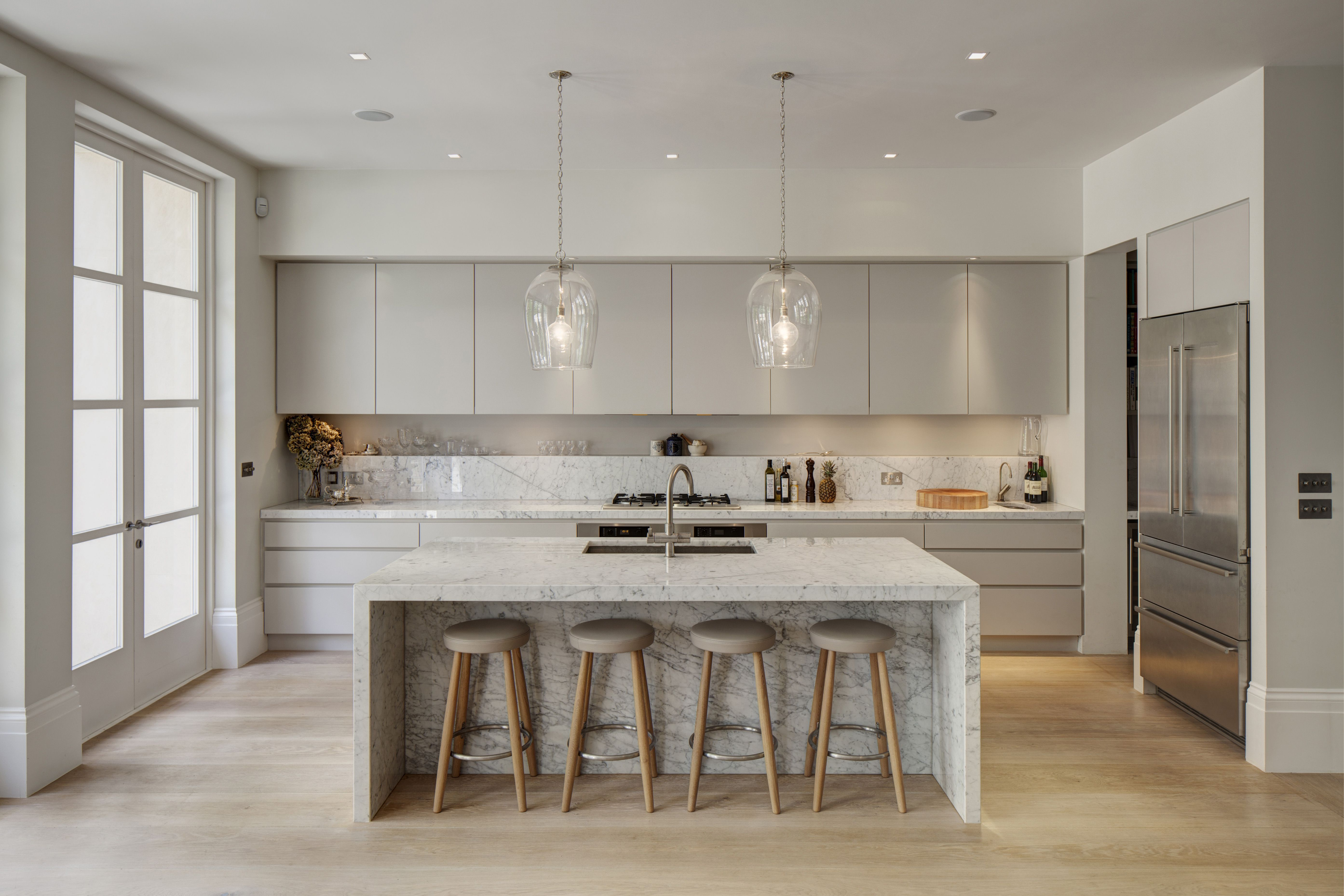 Kitchen with marble island in modern family home 2012, design by De Rosee Sa