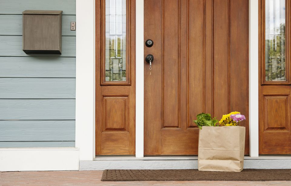 a spacious and open entry door area with a bag of groceries