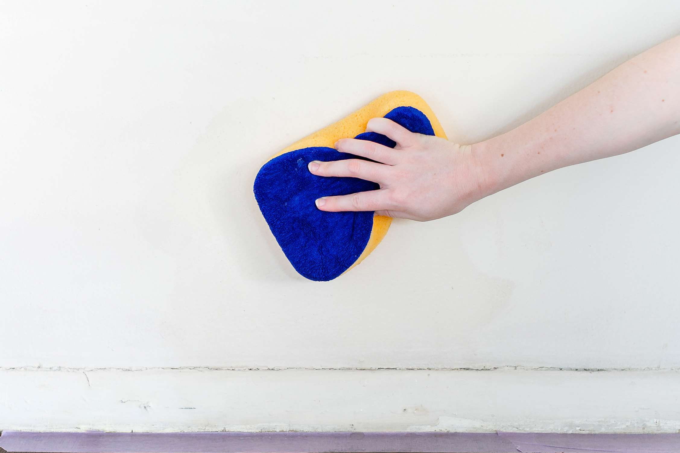 washing walls with a damp sponge