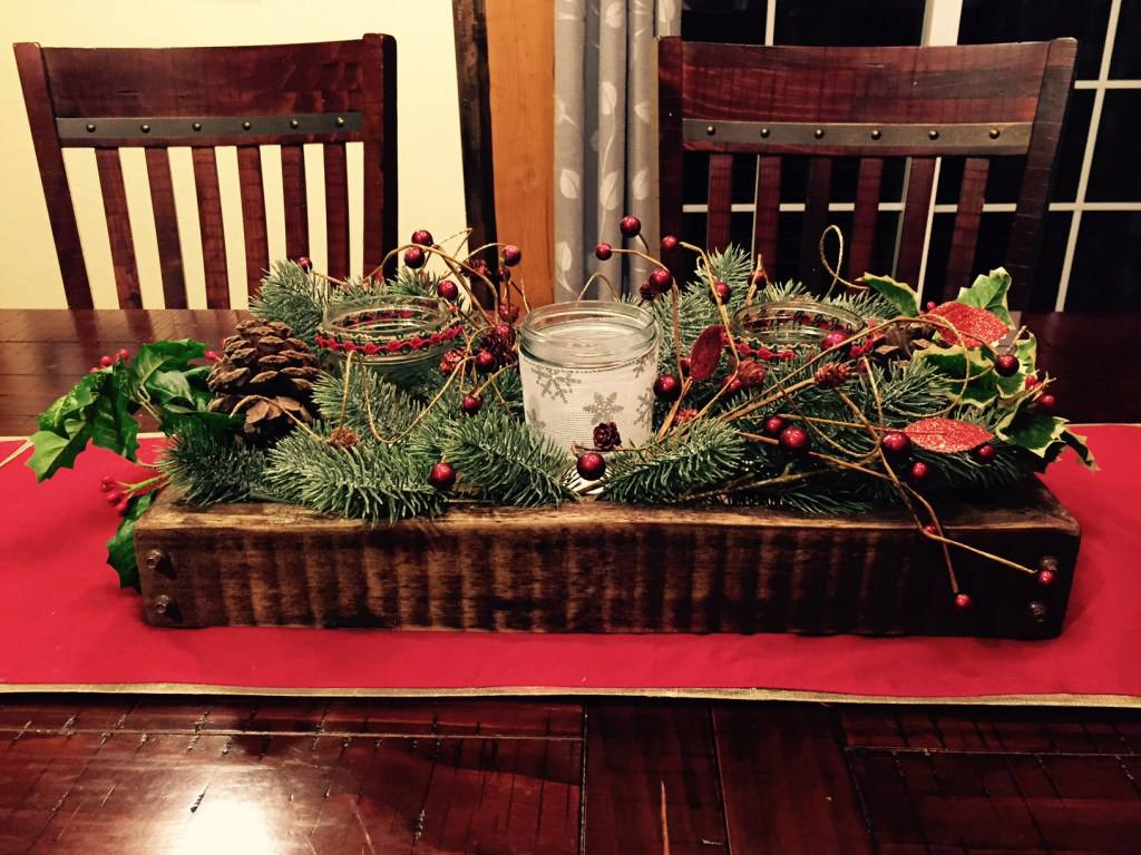 A Christmas table display with red table runner.