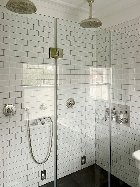 A double shower with subway tile