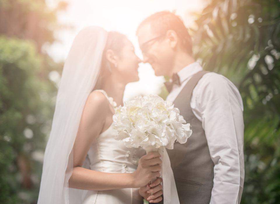 Loving Wedding Couple Standing At Backyard