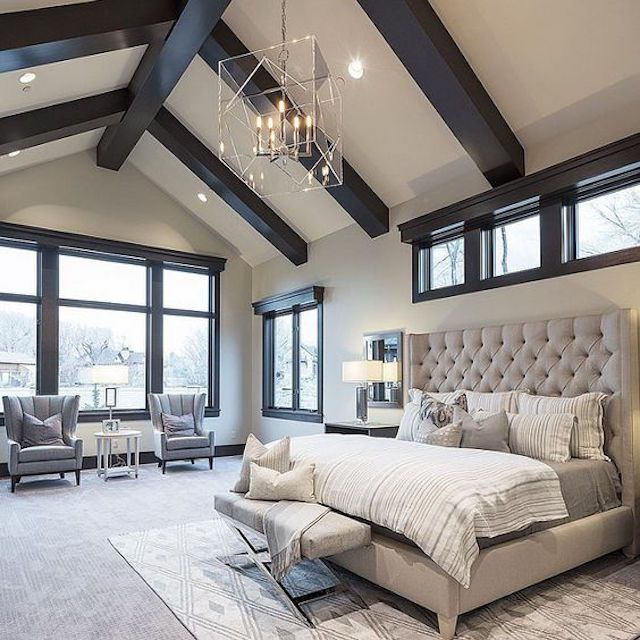 A large bedroom with soothing neutral colors