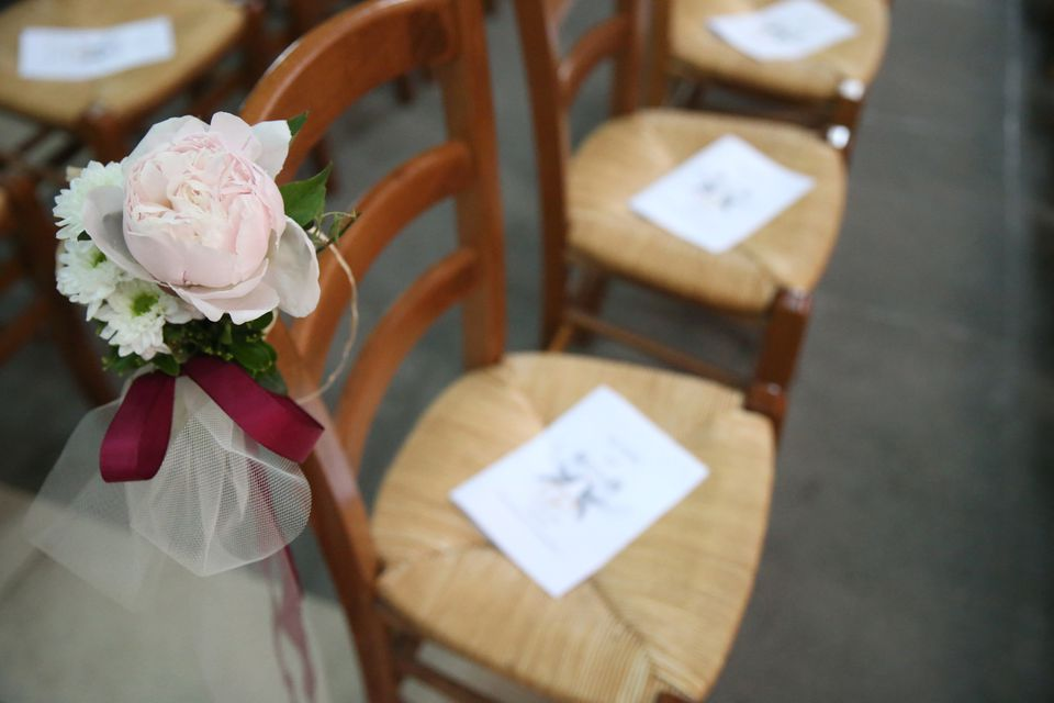 Wedding programs laying on chairs
