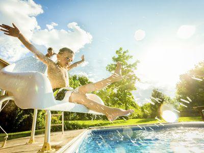 boy on pool slide