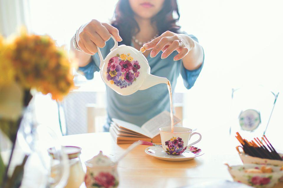 Woman pouring tea.
