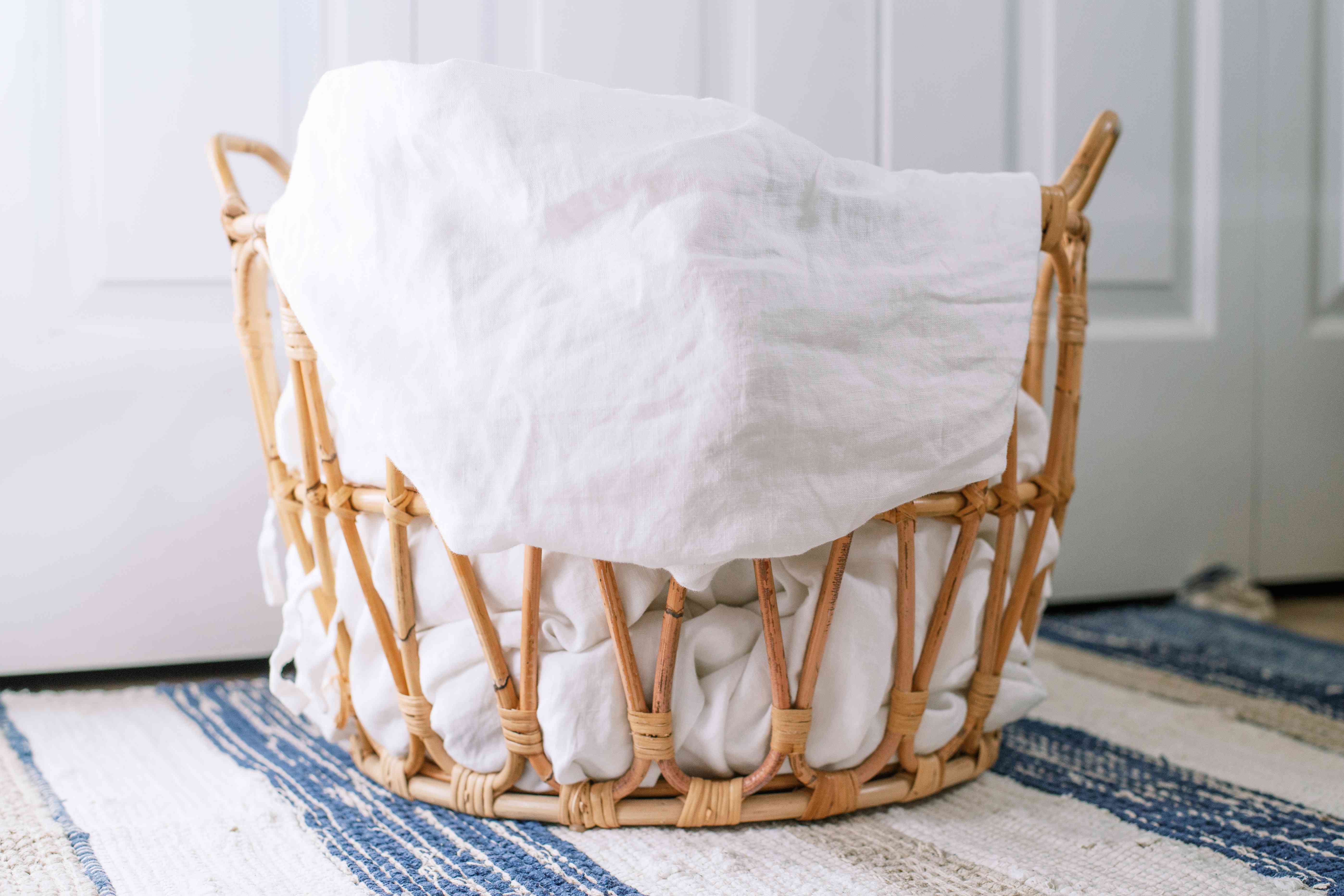 Basket with laundry sorted by color