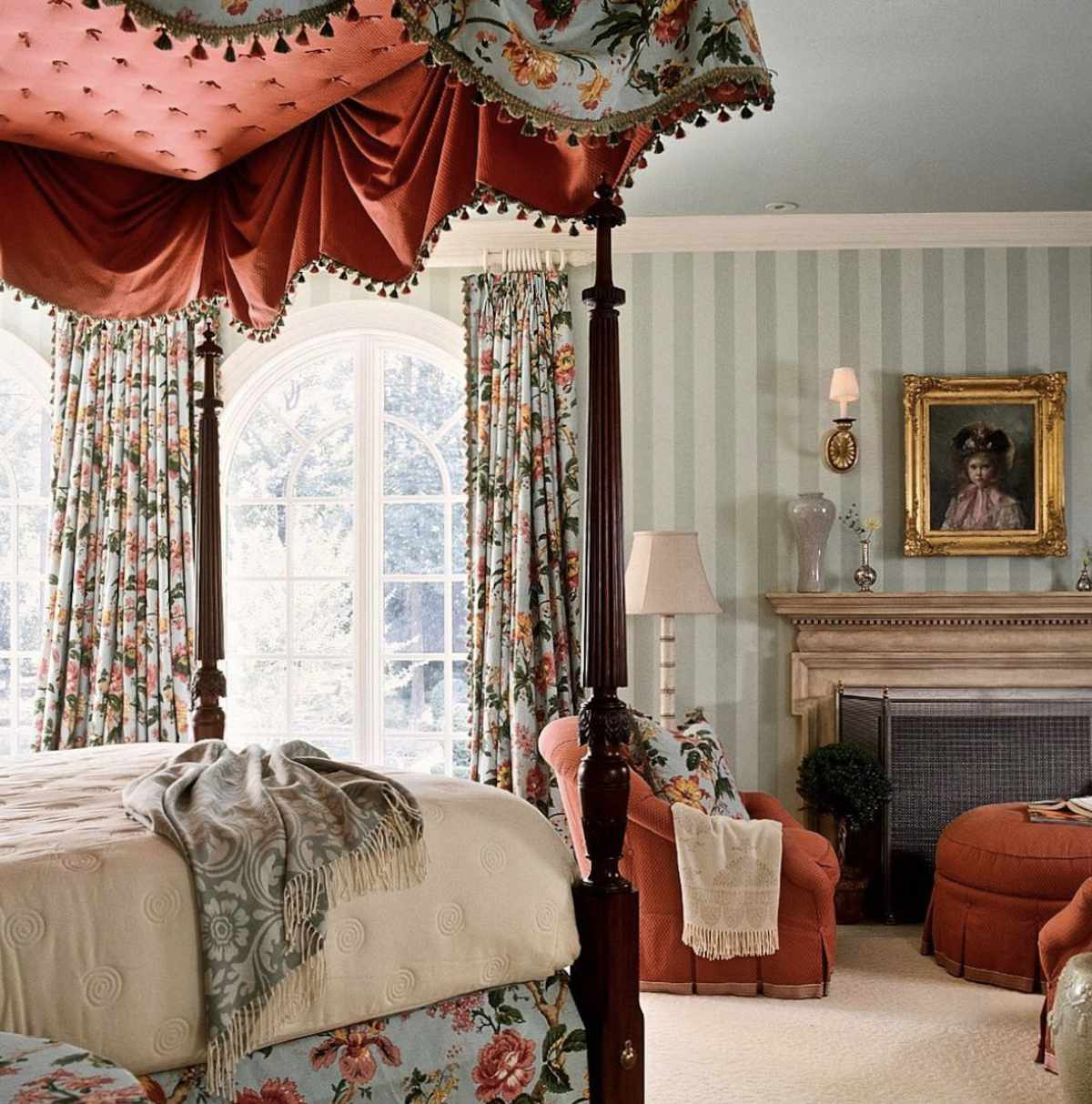 traditional colonial bedroom, red and blue floral pattern, fireplace in bedroom